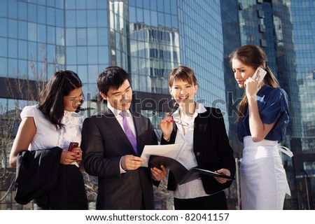Business people meeting outdoor in front of office building