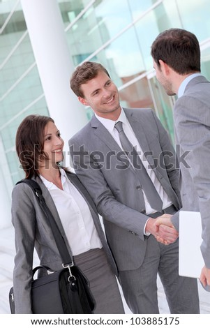 Business people meeting outside office building - stock photo