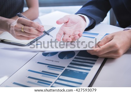 Business people meeting to discuss the situation on the market - stock photo