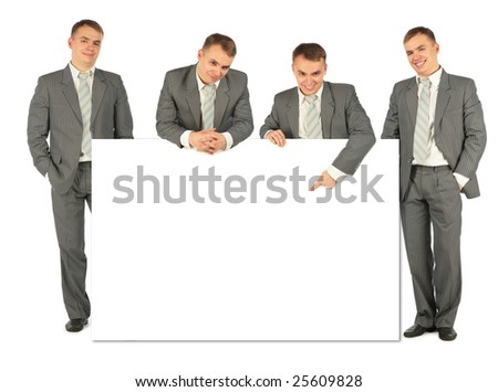 business people of four with board for text - stock photo
