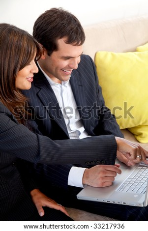 Business people on a laptop in an office - stock photo