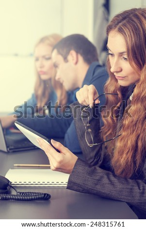Business people on a meeting in an office - stock photo