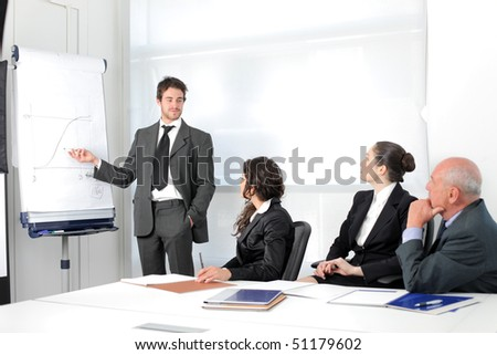 Business people on a meeting with businessman exposing a project - stock photo