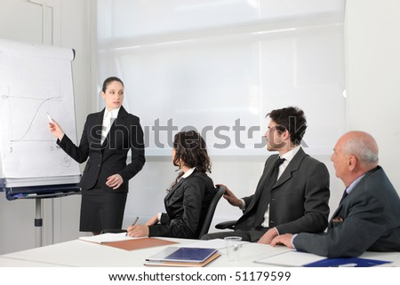 Business people on a meeting with businesswoman explaining a chart - stock photo