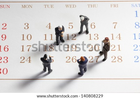 Business people on calender. - stock photo