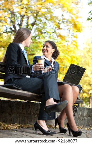 business people on coffee break talking about job - stock photo