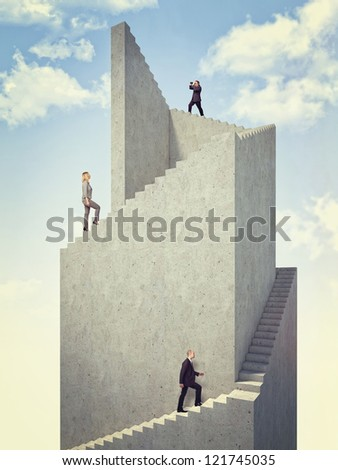 business people on 3d abstract tower - stock photo