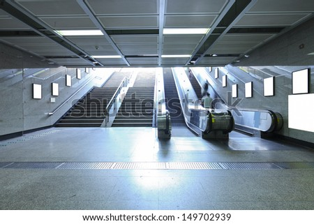 business people on elevator in metro station for transfer - stock photo