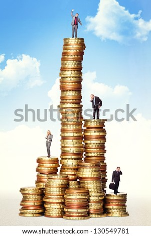 business people on  euro money piles - stock photo