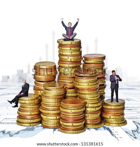 business people on  euro money piles - stock photo