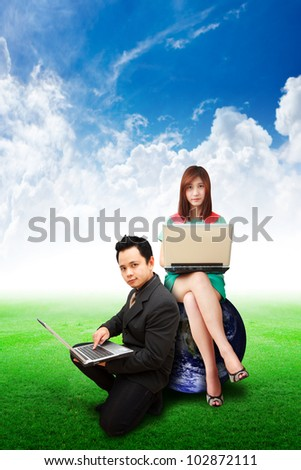 Business people on grass field and blue sky : Elements of this image furnished by NASA
