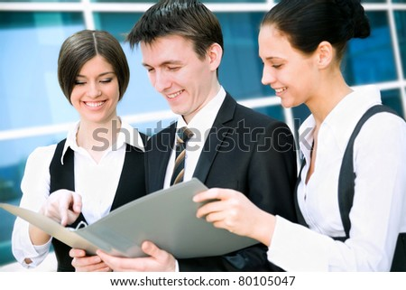 Business people on the background of a modern office building
