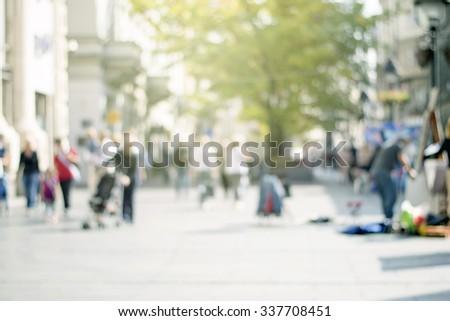 business people on urban city street blur - stock photo