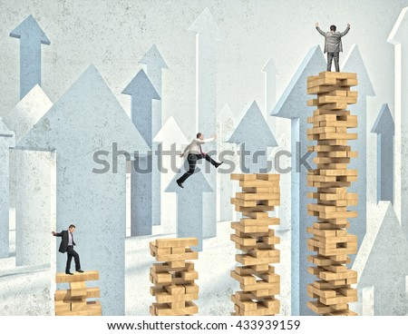 business people on wood toy tower block