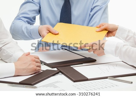 Business people passing an yellow envelope, white background - stock photo