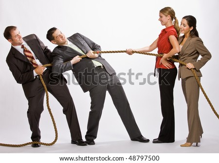 Business people playing tug-of-war - stock photo