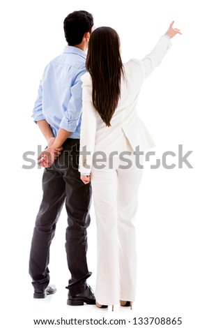 Business people pointing away - isolated over a white background - stock photo