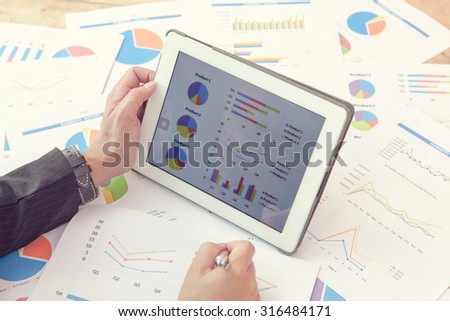 Business people present to discuss the situation on the market - stock photo
