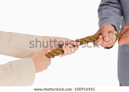 Business people pulling the rope against white background - stock photo