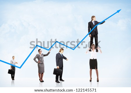business people pushing a business graph upwards - stock photo