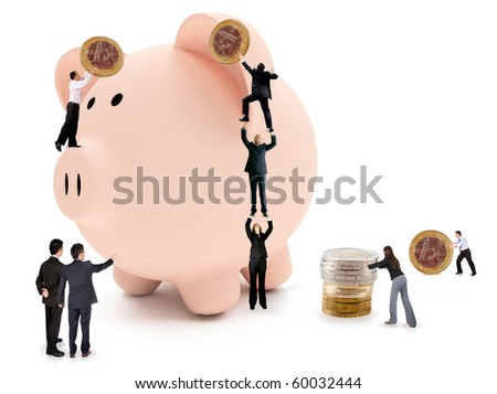 Business people putting savings on a piggy bank - isolated - stock photo