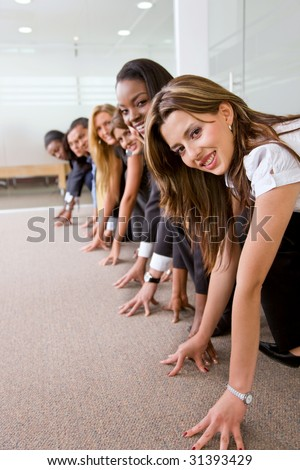 Business people racing against each other in an office - stock photo
