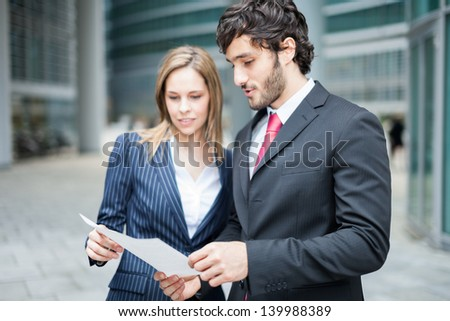 Business people reading a document together - stock photo