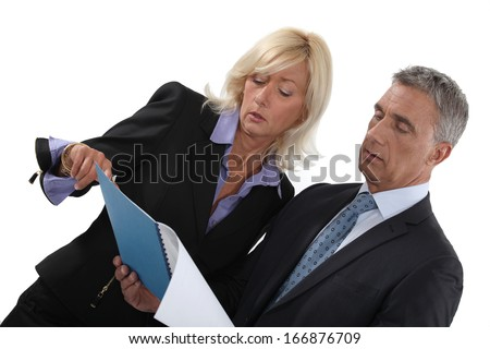 Business people reading a report - stock photo