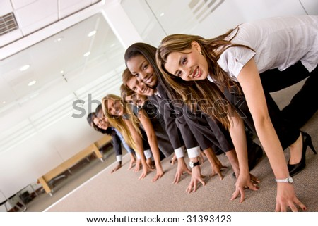 Business people ready to race against each other in an office - stock photo