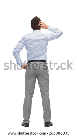 business, people, rear view and office concept - businessman scratching his head from back - stock photo