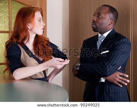Business people - red head freckled young woman and black man standing - series of photos - stock photo