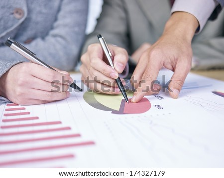 business people reviewing sales performance in a meeting. - stock photo