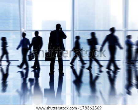 Business People Rushing in Office Building - stock photo