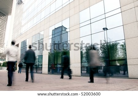 business people rushing in the lobby in motion blur - stock photo