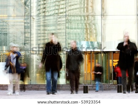 business people rushing in the lobby in motion blur