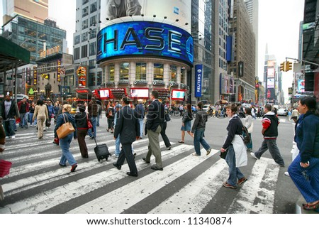 Business people rushing on the street, Manhattan,New York, Times Square - stock photo