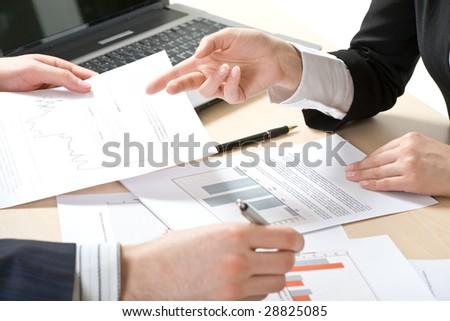 Business people?s hands during teamwork - stock photo