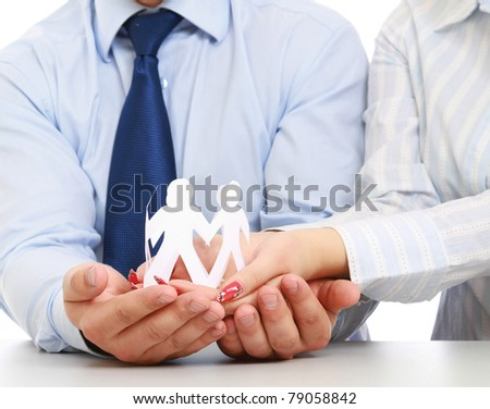 Business people's hands holding paper people, closeup