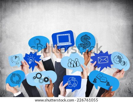 Business people's hands holding the speech bubble with business theme. - stock photo