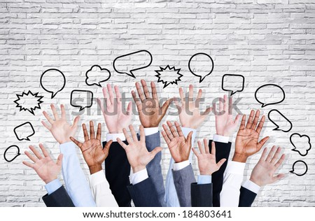 Business People's Hands Raised - stock photo