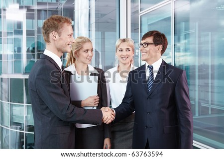 Business people shake hands with each other