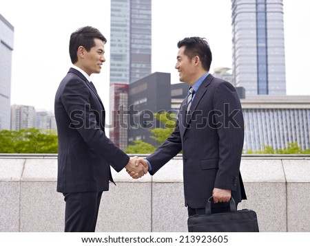 business people shaking hands. - stock photo