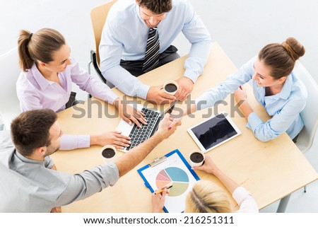 Business people shaking hands across table  - stock photo