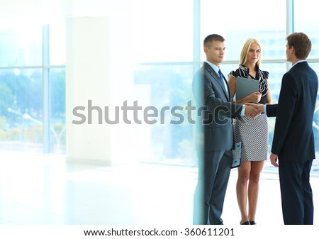 Business people shaking hands after meeting