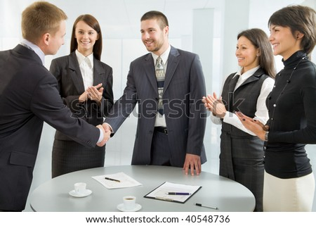 Business people shaking hands after successful negotiations - stock photo