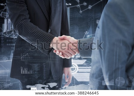 Business people shaking hands against hologram background