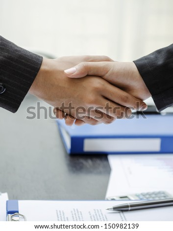 Business people shaking hands at work - stock photo