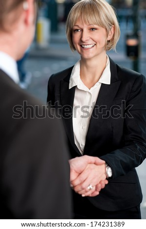 Business people shaking hands, deal finalized - stock photo