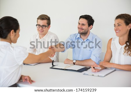 Business people shaking hands during job recruitment meeting in office - stock photo