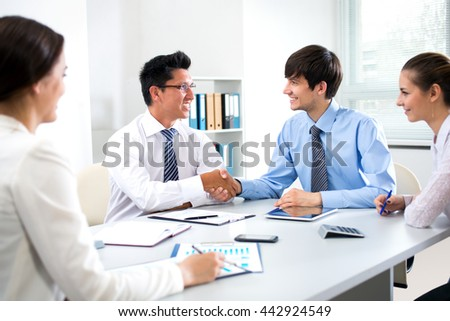 Business people shaking hands during meeting - stock photo